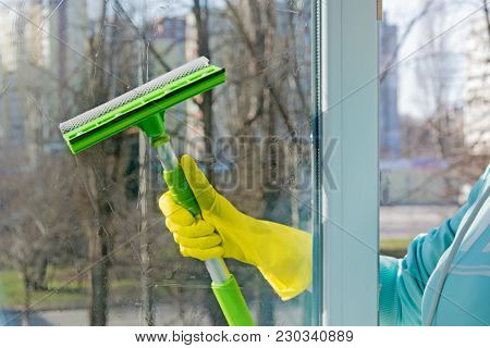Washing The Windows In The Spring. The Concept Of Spring Cleaning At Home