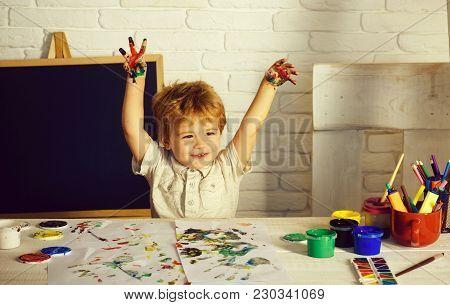 Happy Boy Colors His Hands. Little Children Hands Doing Fingerpainting With Various Colors. Happy Ki