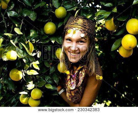 Pretty Islam Woman In Orange Grove Smiling, Real Muslim Girl Cheerful Close Up