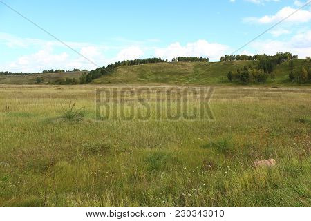 The Field And Hill In Siberia, Russia