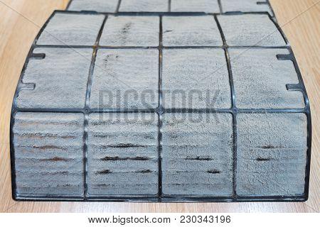 Dust On Air Conditioner Filter On Wood Floor In Condominium