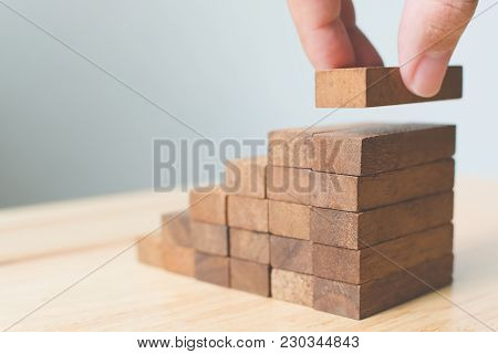 Hand Arranging Wood Block Stacking As Step Stair. Ladder Career Path Concept For Business Growth Suc