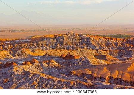 Sunset Over Atacama Desert Panorama In San Pedro, Chile. Rock Formation Patterns Left By Volcanic Ac