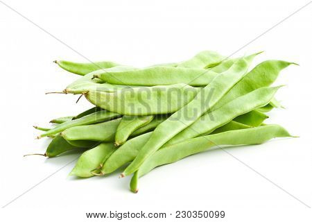 Green string beans pods isolated on white background.