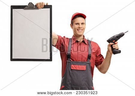 Repairman with a clipboard and a drill machine isolated on white background