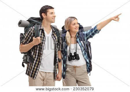 Female hiker showing something in the distance to a male hiker isolated on white background