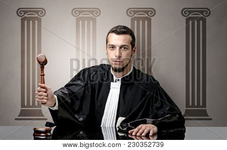 Young judge in front of a courthouse symbol making decision