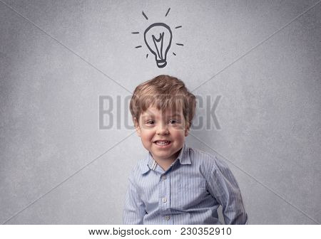 Smart little junior in front of a drawn up grey wall with childlike concept