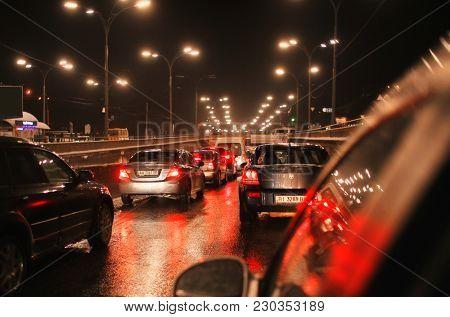 KYIV, UKRAINE - JANUARY 19, 2018: Traffic jam during rush hour in evening