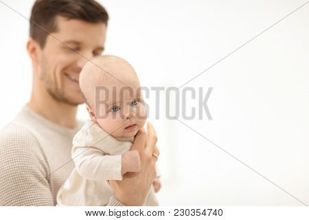 Young father with baby on white background