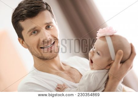 Young father with baby at home