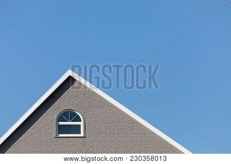 Detail of the typical style houses of Iles de la Madeleine, or the Magdalen Islands, in Canada. Minimalistic style in blue and grey with space for text.