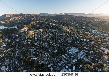 Aerial morning view of hillside homes in the Hollywood Hills neighborhood near Griffith Park in Los Angeles California.
