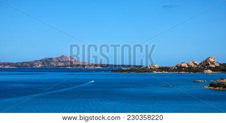 a panoramic view of La Maddalena, Santo Stefano and Caprera islands, in the Strait of Bonifacio, from Palau, in Sardinia, Italy poster