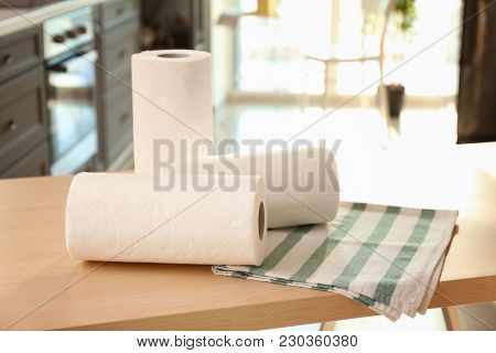 Rolls of paper towels and dishcloth on table indoors