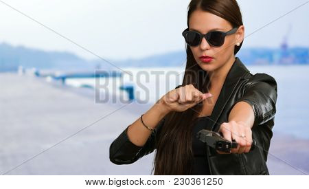Girl Aiming With Gun at a port