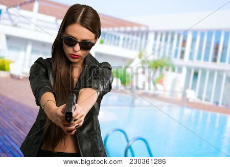 Woman Aiming With Gun, outdoor