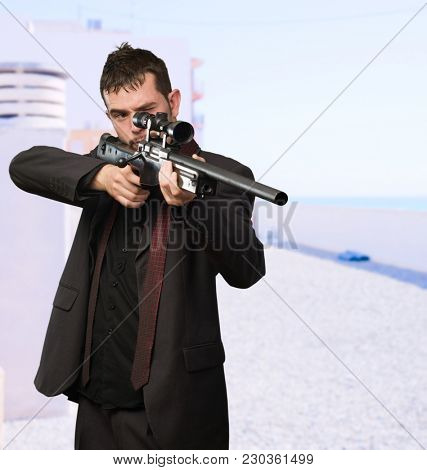 Young Man Aiming With Rifle, outdoor