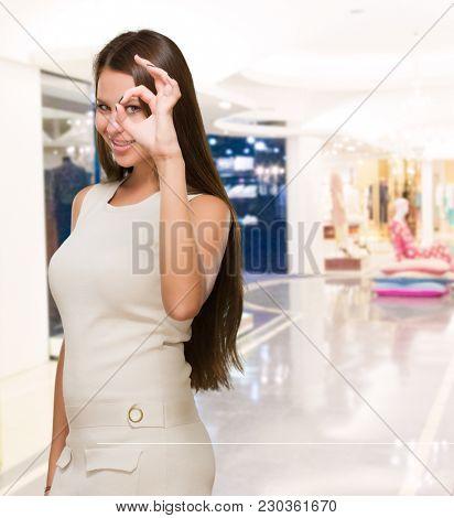 Young Woman Looking Through Imaginary Binocular, indoor
