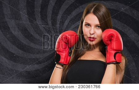 Female Model Wearing Boxing Gloves against a spiral background