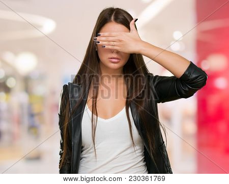 Young Woman Covering Her Eyes, indoor