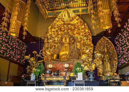 Kamakura, Japan - November 10, 2016: Gold buddha statue of Hase-dera temple in Kamakura, Japan. Hase-dera Buddhist temple is famous for housing a massive wooden statue of Kannon