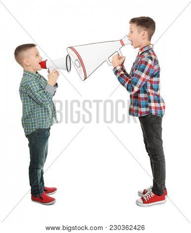 Cute little boys with megaphones on white background