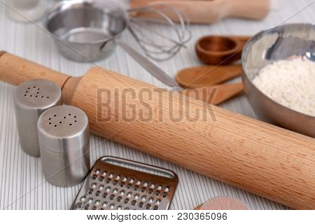 Cooking utensils and flour on table