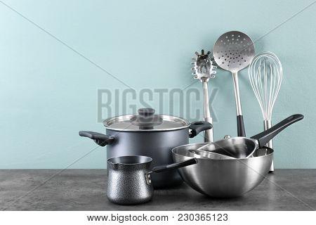 Metal cooking utensils on table