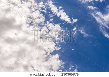 Amazing cumulus cloudscape formation with bright sun light illuminating the clouds and a copy space, great background for your next project poster
