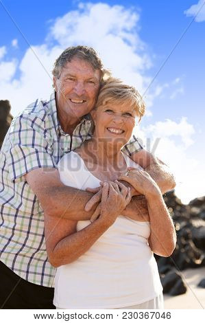Lovely Senior Mature Couple On Their 60s Or 70s Retired Walking Happy And Relaxed Outdoors Under A B