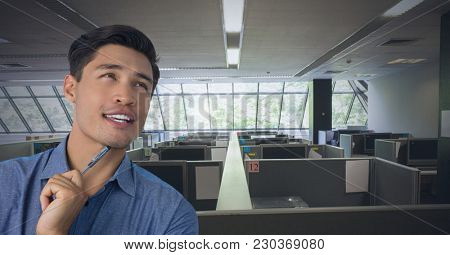 Digital composite of Businessman thinking and holding pen in office