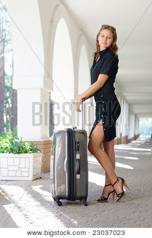 Sexy women with luggage outdoors