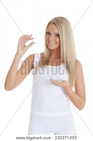 Young slender woman with pills on a white background. Fat burner.