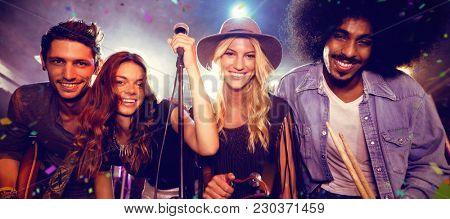 Flying colors against portrait of smiling musicians at nightclub