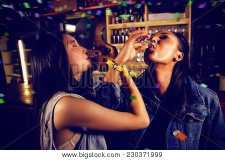 Flying colors against friends having tequila shot