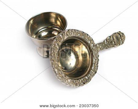 Chromed stainer and cup, on a white background