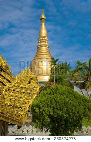 The Spire Of The Shwedagon Pagoda On A Sunny Day. Yangon, Myanmar