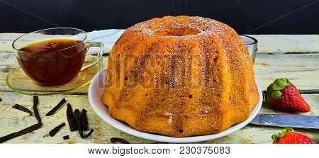 Old Fashioned Sand Cake With Cup Of Black Tea And Pieces Of Vanilla On Wooden Background. Egg-yolk S