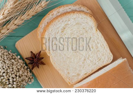 Sliced Soft And Sticky Delicious White Bread On Wood Cutting Board. Prepare Sliced Bread For Breakfa