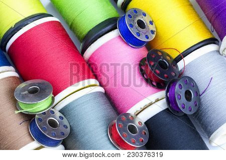 Colourful Thread Bobbins In Diagonal Close-up From Top View