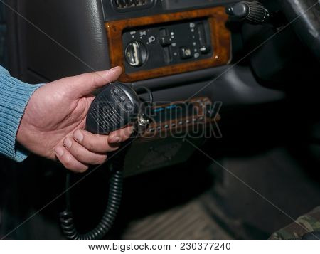 Closeup Of A Male Hand Holding A Cb Car Radio Microphone