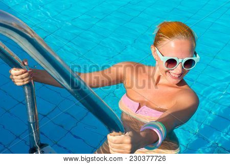 Young Woman Enjoying Warm Water In Pool At Tourist Resort