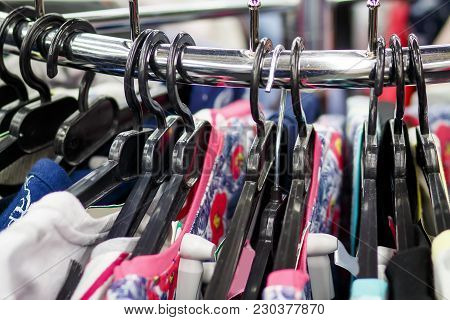 Hangers With Clothes In A Fashionable Clothing Boutique Close-up. Shopping Clothing Concept. Things