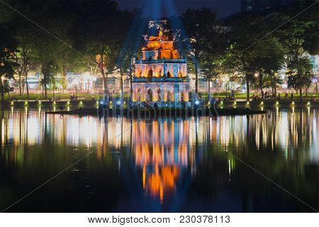 Hanoi, Vietnam - January 10, 2016: Turtle Tower On The Hoan Kiem Lake In The Night Scenery. Hanoi, V