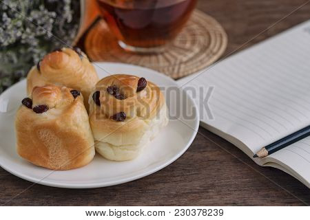 Homemade Soft And Sticky Raisin Bread Or Cinnamon Rolls Look So Delicious. Cinnamon Rolls Served Wit