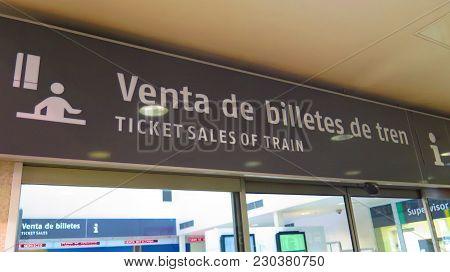 Almeria, Spain - February 10, 2018: Dual Langauage Message At Ticket Office In Almeria Train Station
