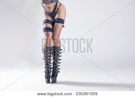 Legs With Stockings And High Heels. Isolated On White Background.