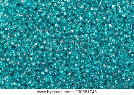 Background Of Turquoise Blue Color Glass Beads