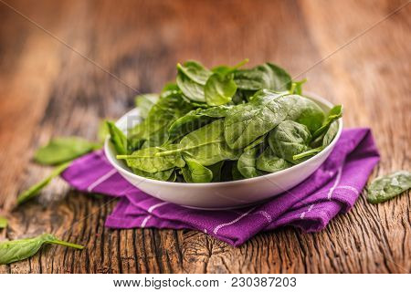 Spinach. Fresh Baby Spinach Leaves In Plate On Woden Table